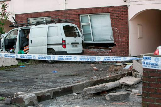 Scene of an overnight crash near the entrance to Beaumont Hospital where a White Van crashed into a house injuring one man