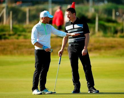 Irish rugby legend Brian O'Driscoll chats with fellow countryman singer-songwriter Ronan Keating during the final practice round of the 2015 Alfred Dunhill Links Championship at The Old Course