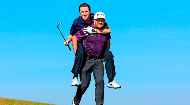 Tony McCoy gets a jockey-back from Graeme McDowell at the Pro-Am for the Alfred Dunhill Links Championships