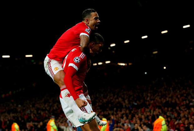 Chris Smalling celebrates with team mate Memphis Depay