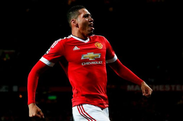 Chris Smalling celebrates as he scores Manchester United's second goal during the UEFA Champions League clash with VfL Wolfsburg at Old Trafford