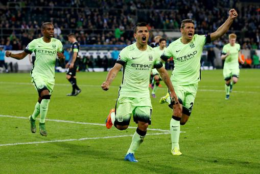 Manchester City's Sergio Aguero celebrates after scoring the winning goal from the penalty spot.