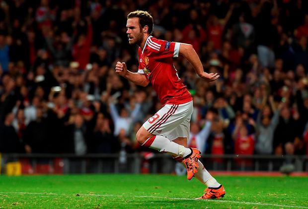 United's Juan Mata running at pace