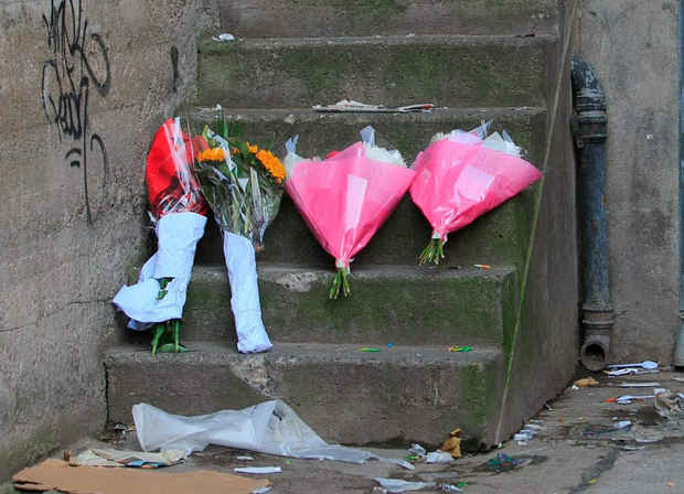Flowers are left on Dawson Lane, where homeless man Alan Murphy died last week