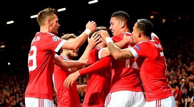 Manchester United's Chris Smalling (second right) celebrates with his team-mates after scoring his side's second goal during the UEFA Champions League Group B match at Old Trafford
