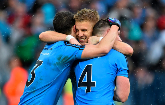 Dublin's Jonny Cooper, centre, Rory O'Carroll, left, and Philip McMahon celebrate at the final whistle. GAA Football All-Ireland Senior Championship Final, Dublin v Kerry, Croke Park, Dublin. Picture credit: Ramsey Cardy / SPORTSFILE