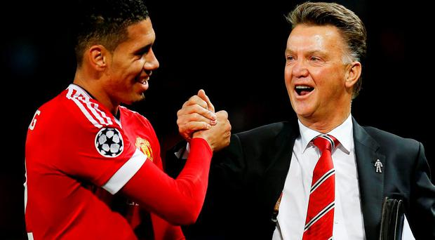 Chris Smalling and Manchester United manager Louis van Gaal