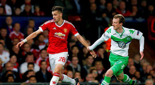 Manchester United's Morgan Schneiderlin in action with Wolfsburg's Maximilian Arnold
