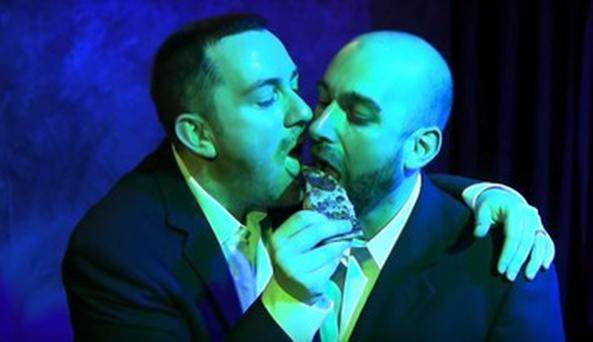 Robin Trevino and Jason Degatto eating pizza from the anti-gay restaurant at their wedding
