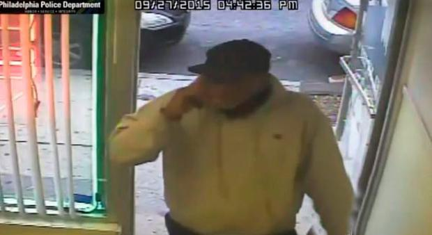 Police described the armed robber as a black male, aged between 30 and 40-years-old with a stocky build Credit: Philadelphia Police Department