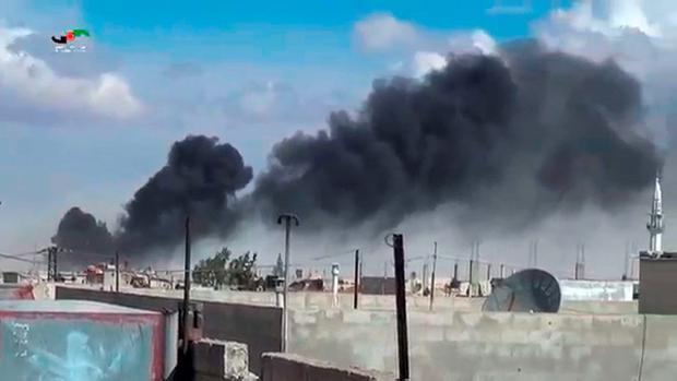 An image grab taken from a video released by the Homs Media Center shows smoke billowing from buildings in the central Syrian town of Talbisseh in Homs province. The Syrian Observatory for Human Rights reports at least 27 civilians had been killed in air strikes in the Homs province Credit: Homs Media Center