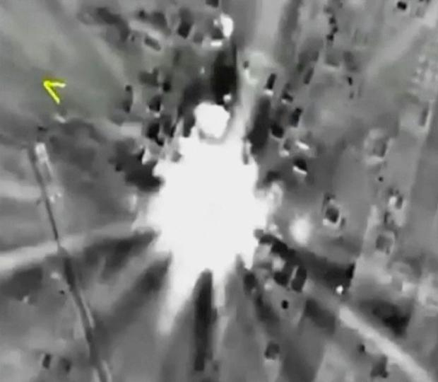 Russian jets hitting a target in Syria, which the Kremlin says includes a list of well-known militant organisations, not only Islamic State Credit: Russian Defense Ministry Press Service