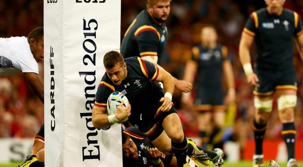 Gareth Davies of Wales scores the opening try of the match against Fiji at the Millennium Stadium
