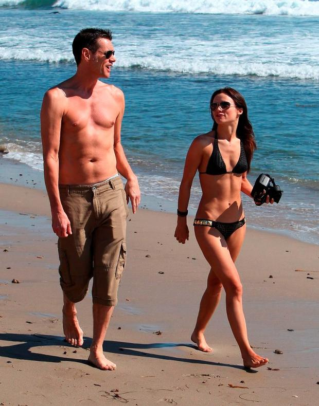 Early days: Jim Carrey and Cathriona White were first photographed together on a Malibu beach in 2012