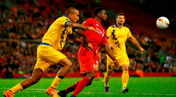 Leo Lacroix of FC Sion and Divock Origi of Liverpool compete for the ball