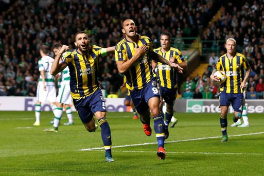 Fenerbahce's Fernandao celebrates scoring their second goal with Mehmet Topal