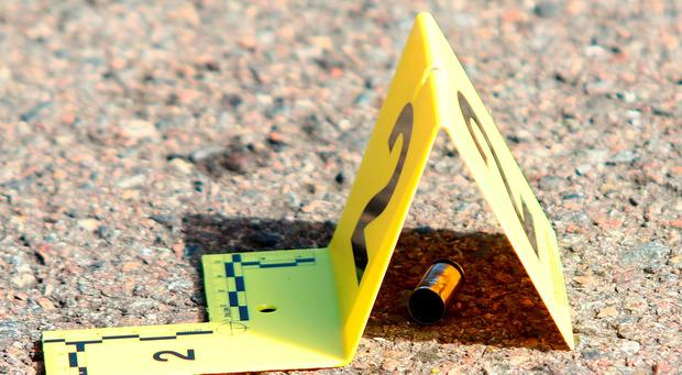 A bullet casing is marked at the scene of a deadly shooting at Umpqua Community College in Roseburg, Ore (Michael Sullivan/The News-Review via AP)