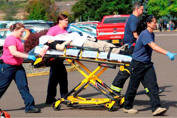 First responders transport an injured person following a shooting incident at Umpqua Community College in Roseburg, Oregon October 1, 2015. REUTERS/Michael Sullivan/The News-Review