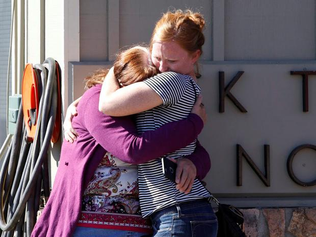 Umpqua Community College alumnus Donice Smith (L) is embraced after she said one of her former teachers was shot dead, near the site of a mass shooting at Umpqua Community College in Roseburg,Oregon October 1, 2015. REUTERS/Steve Dipaola