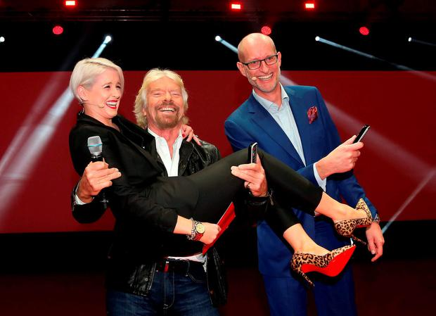 Richard Branson and Sinead Kennedy pictured this morning at the RDS with Magnus Ternsjo CEO of UPC Ireland. Picture: Colin Keegan/Collins Dublin