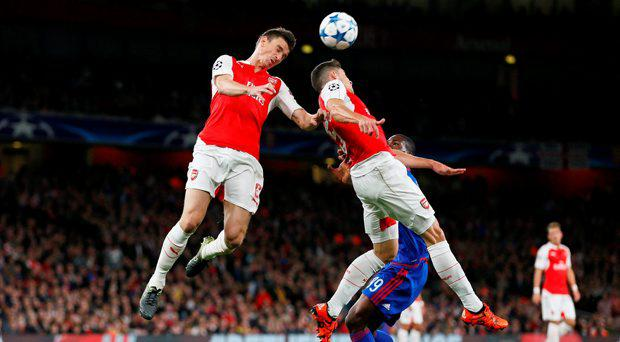 Arsenal's Gabriel Paulista and Laurent Koscielny in action