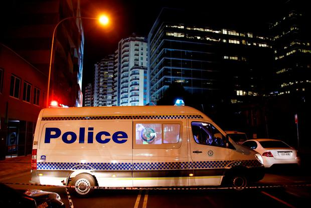 A police van blocks a street outside the New South Wales state police headquarters located in the Sydney Credit: David Gray (REUTERS)