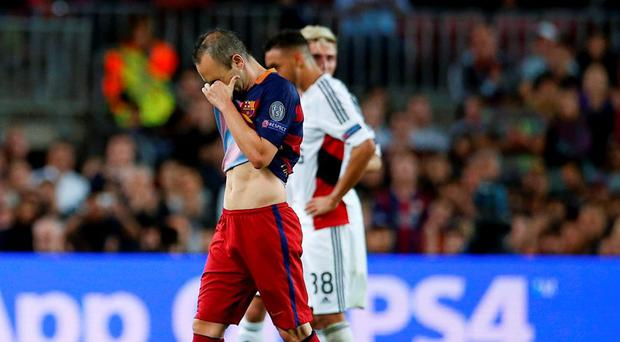 Barcelona's Andres Iniesta walks off the pitch during their Champions League group E soccer match against Bayer Leverkusen at Camp Nou stadium