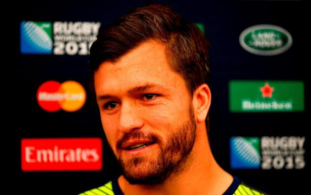 Adam Ashley-Cooper of Australia speaks to the media following the Australia Captain's Run ahead of the 2015 Rugby World Cup Pool A match against England at Twickenham