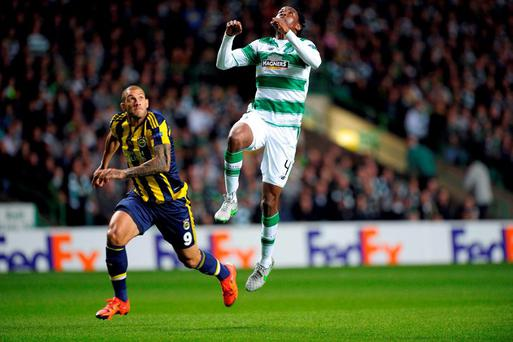 Celtic's Nigerian defender Efe Ambrose (R) vies with Fenerbahce's Brazilian striker Fernandao (L) in the build up to Ferbahce's first goal during UEFA Europa League group A football match between Celtic and Fenerbahce at Celtic Park
