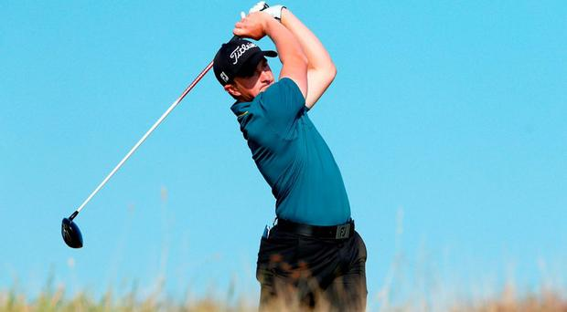Paul Dunne of Ireland drives off the nineth tee during the second round of the 2015 Alfred Dunhill Links Championship at The Old Course today at St Andrews