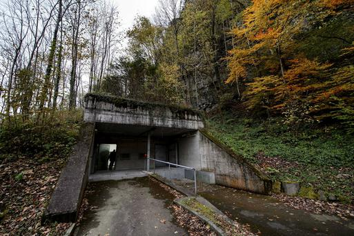 The entrance to a former Swiss bunker built in the Alps during the Cold War Credit: Fabrice Coffrini/AFP via Getty Images