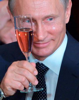 Russia's President Vladimir Putin toasts during a luncheon hosted by UN Secretary General Ban Ki-moon at the United Nations headquarters earlier this week in New York Photo: Mandel Ngan/AFP