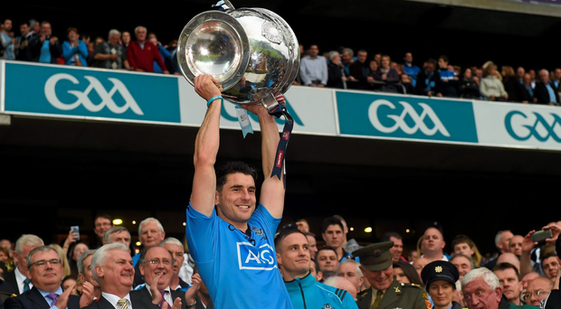 Bernard Brogan lifts the Sam Maguire Cup after the game