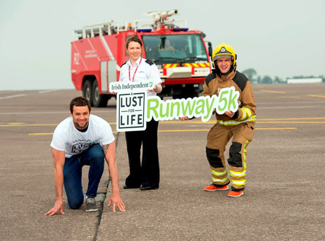 Bressie on the apron of Cork Airport yesterday, preparing with airport security team member Martha Callanan and airport firefighter Peter Ronayne for the upcoming 'Irish Independent' A Lust For Life Runway 5k