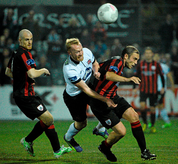 Dundalk's Chris Shields (l) in action against Longford Town's Stephen Rice during the FAI Cup semi-final at Oriel Park last night.