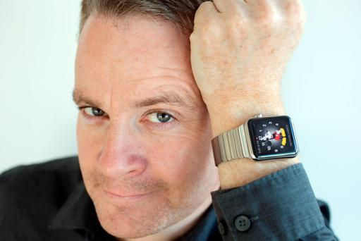 Ronan Price tries on the new Apple Watch, which went on sale here last week Photo: Tony Gavin