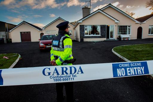 A garda outside the Corcorans' home after the break-in Photo: Mark Condren