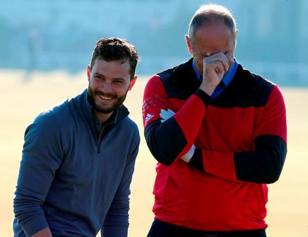 Jamie Dornan (left) and Steve Redgrave during day one of the Alfred Dunhill Links Championship at Old Course St Andrews