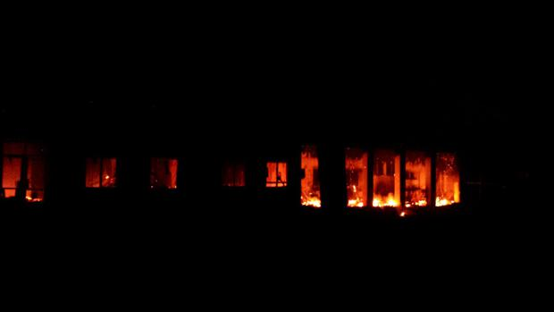 Fire is seen inside a Medecins Sans Frontieres (MSF) hospital building after an air strike in the city of Kunduz, Afghanistan in this October 3, 2015 MSF handout photo. MANDATORY CREDIT REUTERS/Medecins Sans Frontieres/Handout via Reuters