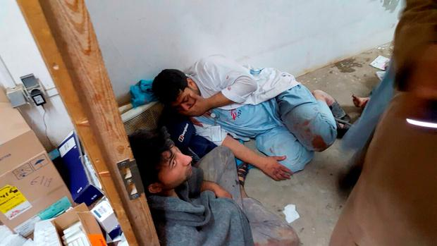 Afghan staff react inside a Medecins Sans Frontieres (MSF) hospital after an air strike in the city of Kunduz, Afghanistan in this October 3, 2015 MSF handout photo. The U.S. military on Saturday acknowledged it may have bombed a hospital run by medical aid group Medecins Sans Frontieres in the Afghan city of Kunduz in an air strike that killed at least nine people and wounded 37. MANDATORY CREDIT REUTERS/Medecins Sans Frontieres/Handout via Reuters ATTENTION EDITORS - FOR EDITORIAL USE ONLY. NOT FOR SALE FOR MARKETING OR ADVERTISING CAMPAIGNS. THIS PICTURE WAS PROVIDED BY A THIRD PARTY. REUTERS IS UNABLE TO INDEPENDENTLY VERIFY THE AUTHENTICITY, CONTENT, LOCATION OR DATE OF THIS IMAGE. THIS PICTURE IS DISTRIBUTED EXACTLY AS RECEIVED BY REUTERS, AS A SERVICE TO CLIENTS. NO SALES.
