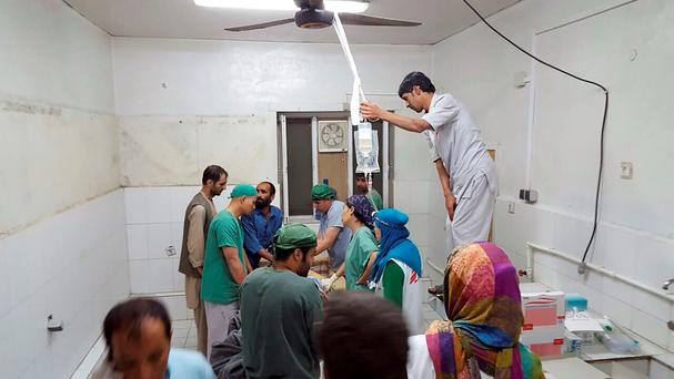 Afghan (MSF) surgeons work inside a Medecins Sans Frontieres (MSF) hospital after an air strike in the city of Kunduz, Afghanistan in this October 3, 2015 MSF handout photo. REUTERS/Medecins Sans Frontieres/Handout via Reuters