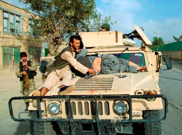 A military vehicle transports an injured civilian after a battle with the Taliban in the city of Kunduz, Afghanistan October 3, 2015. Fighting has raged around the Afghan provincial capital, recaptured by government forces this week from Taliban militants who had seized it in the biggest victory of their nearly 14-year insurgency. REUTERS/Stringer
