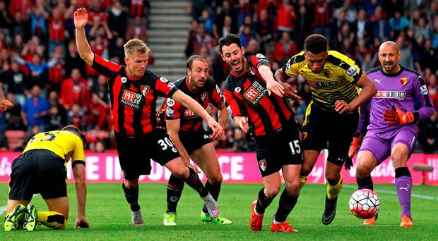 Players tussle for the ball during the Barclays Premier League match between A.F.C. Bournemouth and Watford at Vitality Stadium