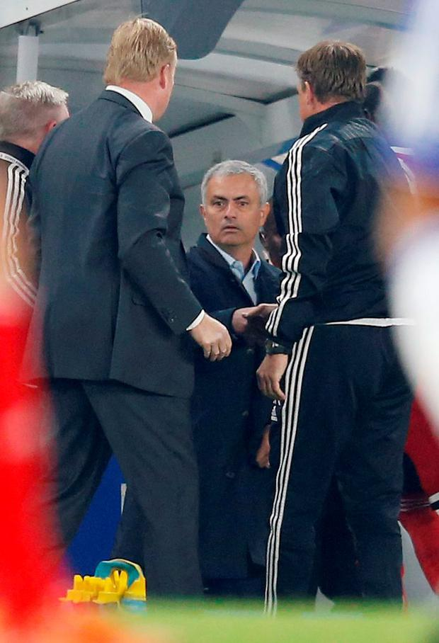 Football - Chelsea v Southampton - Barclays Premier League - Stamford Bridge - 3/10/15 Chelsea manager Jose Mourinho shakes hands with Southampton assistant manager Erwin Koeman (R) as Ronald Koeman looks on Action Images via Reuters / Paul Childs Livepic