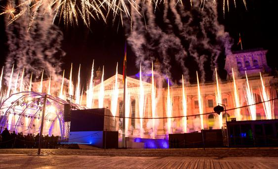 Fireworks explode during the celebration of the 25th anniversary of German reunification in front of the Reichstag in Berlin, October 3, 2015. REUTERS/Axel Schmidt