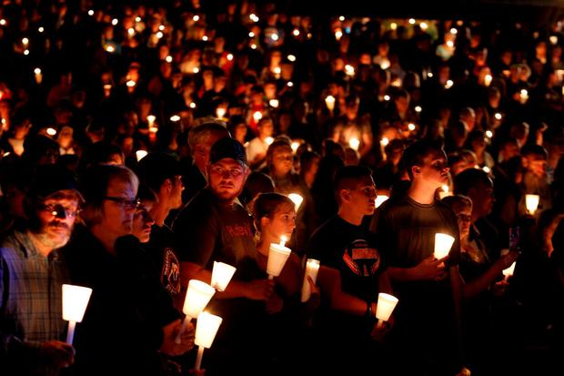 EMPATHY IN ACTION: People take part in candlelight vigil following the mass shooting at Umpqua Community College in Roseburg, Oregon