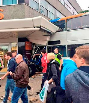 The bus was travelling through Hale Street when it collided with a number of stationary cars and a lamppost before crashing into the supermarket on Trinity Street at 6pm, West Midlands Police said. Photo: @Haroon_Mota/PA Wire