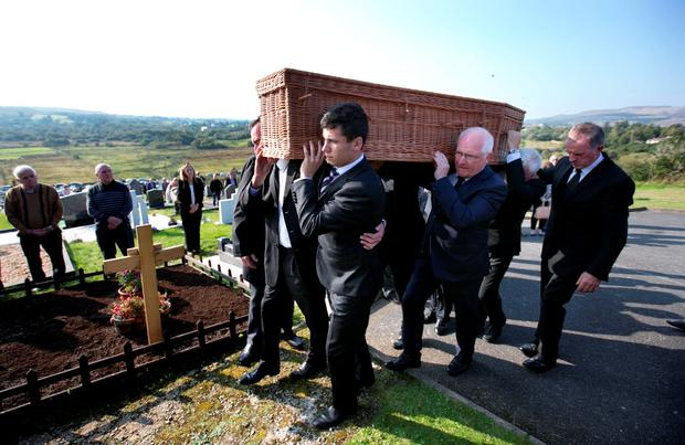 Family and Friends carry the remains of Playwright Brian Friel to the graveside for the burial ceremony for writer and playwright Brian Friel at Glenties cemetary. Picture Credit: Frank Mc Grath 4/10/15