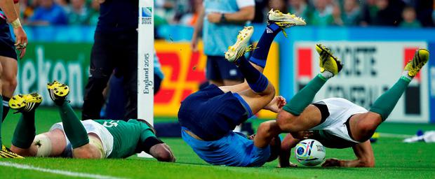 Rugby Union - Ireland v Italy - IRB Rugby World Cup 2015 Pool D - Olympic Stadium, London, England - 4/10/15 Italy's Leonardo Sarto in action with Ireland's Conor Murray Reuters / Eddie Keogh Livepic
