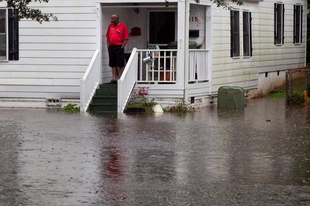 A resident along Orange Street watches the level of floodwaters in Georgetown, South Carolina October 4, 2015. REUTERS/Randall Hill